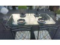 metal wrought iron and glass top with 4 upholstered chairs