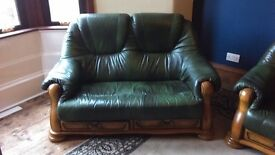 2 x two seater green leather sofa, good condition £50 ono
