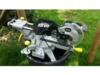 Sliding mitre saw with laser