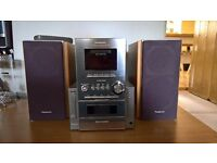 ** Panasonic Stereo System - 5CD changer, tape deck, radio, aux-in **