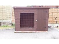 Dog kennel with run with insulated sleeping area and storage room. Buyer to collect.