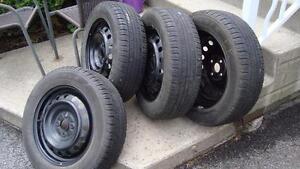 "4-OEM Toyota Yaris Black Steel rims 4X100-15"" & 185-65-15"" Tires"