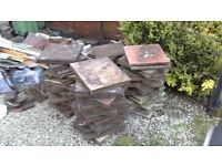 Free paving slabs in driveway ready for collection