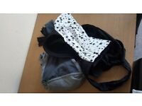 Two baby carriers for sale £10 (one caboo).