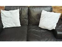 black leather two /two seater sofas