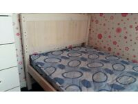Single white wood bed