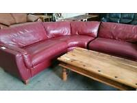 Red leather corner sofa and matching armchair