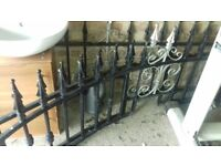 2 curved metal railings