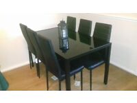 Black glass 6 seat dinning table