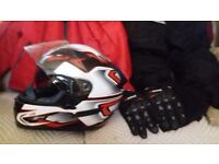 Full Ladies size 18 Motorcycle Suit and helmet never worn. Gloves as well