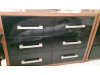 Solid heavy large drawers. 2 sets and 2 bedside drawers. Black /oak. Excellent condition.