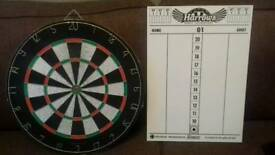 Dart board (used) with wipe clean scoreboard and set of darts with 3 flights