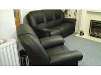 Black Italian leather sofa and chair only 11 months old