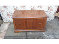 brown wood blanket box with lift up lid