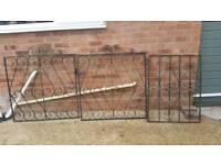 Metal Gates and Wooden Fencing.