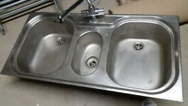 Double kitchen/ utility room sink, with tap. Good condition.