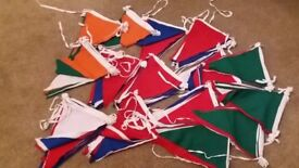 "17 sets of large bunting. Cotton flags measuring 10"" Wide x 16"" in length."