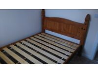 Double solid wood bed frame .
