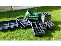 Plastic seed trays and hanging baskets