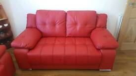 2 x red leather sofas