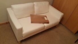 Two seater sofa with spare covers