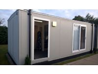 Portable building with selection of new dresses for sale