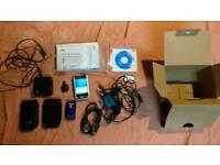 Dell Axim X50V PDA with accessories.