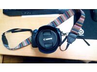 Canon 60D with ultra wide-angle 10-18mm lens (free tripod and 16gb memory card)