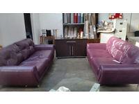Stunning 2 x 2 large purple leather sofas