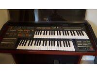 Yamaha Electone Organ in good working order and several organ music books