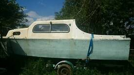 Freeman 22 project boat with trailer for sale.