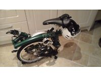 Brand New Brompton collapsible bike, Never been used. Two gears, dark green. Perfect condition.