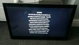27 inch led tv remote built in dvd wall bracket and belkin power surge worth 30 on own