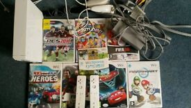 Wii console and 2 controls 2 nunchucks + 11 games