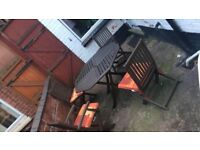 Wooden garden furniture set complete with 4 chairs, cushions and a table, excellent condition!