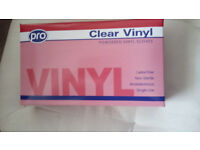 8 boxes of clear vinyl gloves - latex free
