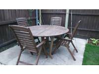Garden table and 4 recliners