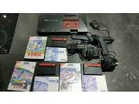 Sega Master System with games, gun and controllers