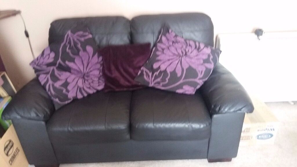 Leather two seater sofa black, two years old, excellent condition