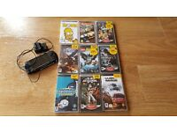 PSP e1000 Console , Original Charger , 8 Games and 1 Movie