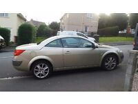 Stunning looking gold convertible, low mileage