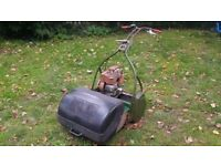 Petrol vintage lawnmower with Briggs and Stratton engine