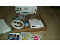 Nintendo Wii complete console with 3 games Wii Fit board Nintendo Wii wheel