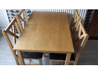 Kitchen table and 4 chairs in excellent show room condition.