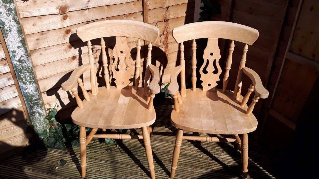 2 solid wood country style carver chairs