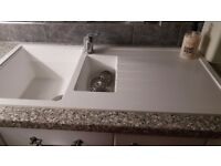 Sink and taps white with grey speckles