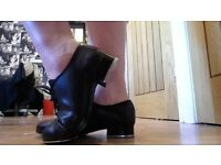 Tap dance shoes with black leotard.