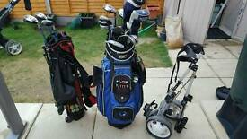Two golf bags including ladies full set of clubs. Right handed. Plus a pull along trolley.