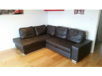 Large brown faux leather corner sofa bed for sale.Double sofa bed with storage.