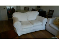 Great 2 seater cream sofa with extra set of washable covers